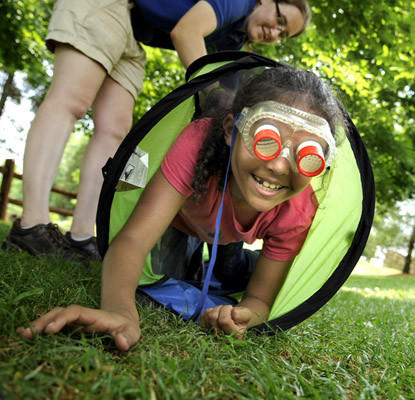 Tamyra Green, 8, of Albrightsville emerges from a tube while making like a bee in the Bug Eyes event. The activity replicates bugs' vision as they move around. This was in the Zoolympics held at Lehigh Valley Zoo Saturday.