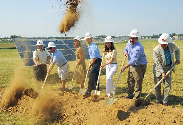 Maryland Gov. Martin O'Malley, center in blue shirt, breaks ground with others during the solar farm ground breaking Saturday on Roxbury Rd.