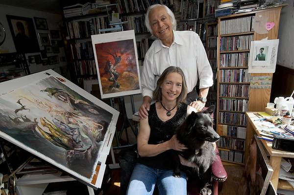 Boris Vallejo and wife Julie Bell in their Lehigh Valley studio/home with Stella, their 2-year-old Border Collie, Eskimo.