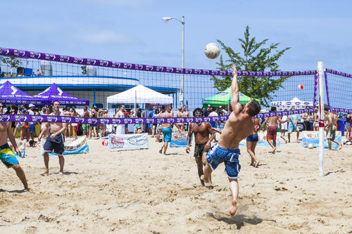 Volleywood attendees play volleyball and hang out in the sun on a beautiful day on North Avenue Beach in Chicago on Saturday, July, 7, 2012 (Brock Brake/RedEye)
