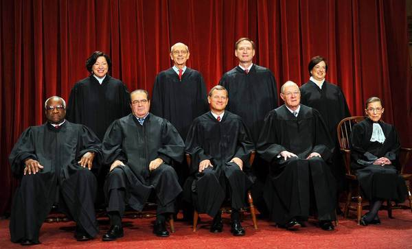 Supreme Court Chief Justice John G. Roberts Jr., center front, showed this year that he wasn't welded to the conservative majority.