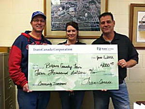 TransCanada recently donated $4,000 to the Brown County Fair through its community investment program. From left: Conald Burgard, Brown County Fair board president, Amy Scott, Brown County Fair manager and Doug Larson, an operations manager with TransCanada.