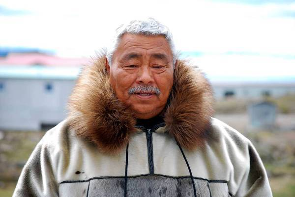 Lew Philip, a veteran Inuit polar bear hunter, says he bagged his first one at age 8. Like many elders, he resents outside interference in how the Inuit manage the polar bear population.
