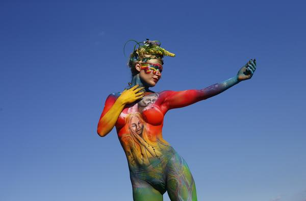 A participant poses with her body paintings during the 15th World Bodypainting Festival in Poertschach on July 7, 2012. Some 30,000 visitors are expected at the three-day event, with over 200 artists from 44 countries showing off their creations in the hope of taking home a prestigious World Award, the equivalent of a world championship title.