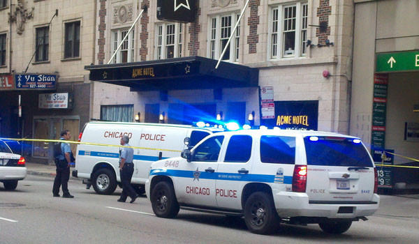 Police at a downtown hotel where a man jumped or fell from a hotel room window Sunday morning and died.