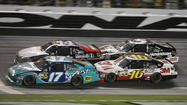 Matt Kenseth (17) leads Tony Stewart (14), Greg Biffle (16), and Kasey Kahne (5) in the second-to-last lap during the Coke Zero 400 NASCAR Sprint Cup race at Daytona International Speedway on Saturday, July 7, 2012.