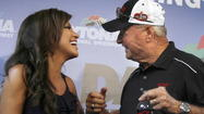 Bobby Bowden, former football coach at Florida State, right, laughs with television personality Robin Meade during a press conference before the Coke Zero 400 NASCAR Sprint Cup race.