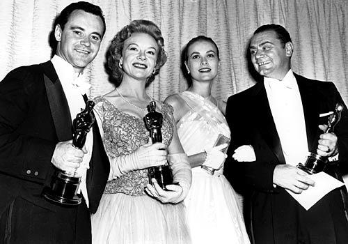 "With Grace Kelly on one arm, Borgnine, right, holds his Oscar for best actor, which he won for 1955's ""Marty."" With him are fellow 1955 Oscar winners Jo Van Fleet (best supporting actress for ""East of Eden"") and Jack Lemmon (best supporting actor for ""Mister Roberts"")."