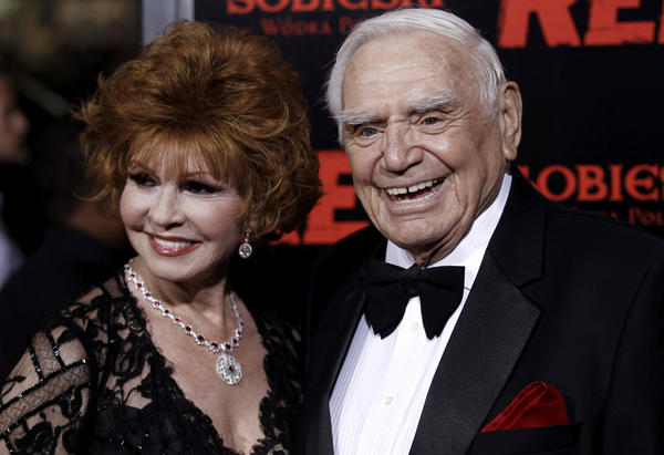 "In this 2010, file photo, cast member Ernest Borgnine, right, and his wife, Tova, arrive at a special screening of the film ""Red"" in Los Angeles.  A spokesman said Sunday,  that Borgnine has died at the age of 95."