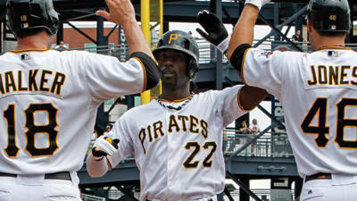 Pittsburgh Pirates Andrew McCutchen (22) is greeted by teammates Neil Walker (18) and Garrett Jones (46) after hitting a two-run home run off San Francisco Giants pitcher Tim Lincecum during the first inning on Sunday.