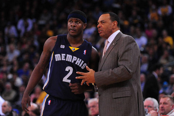Memphis Grizzlies coach Lionel Hollins gives instructions to former Lake Clifton guard Josh Selby.
