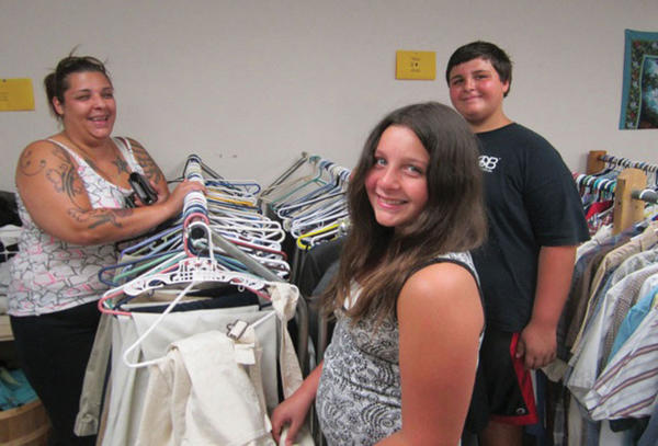 Christen Schwarz, left, and her daughter, Steffanie Schwarz, 11, and son, Alex Schwarz, 13, shop last week at the Jefferson County Community Ministries Clothes Closet.