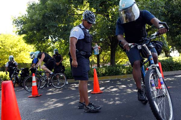 Chicago police Officer Julio Guevara, left, instructs other officers during a bike patrol certification class last month near a training facility on the Near West Side.
