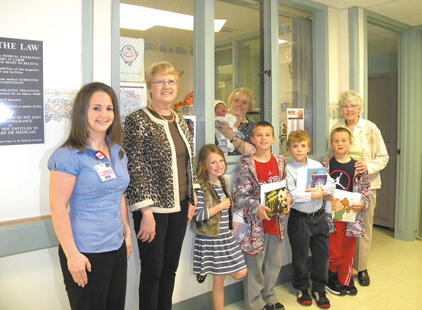 Shepherdstown Elementary School students who raised the most money from the Roadrunner readathon fundraiser recently presented $1,850 to Jefferson Memorial Hospital for the First Book For Babies program.  Pictured, from left, are Megan Nesslerodt, obstetrics clinical coordinator at Jefferson Memorial Hospital; Suzanne Offutt, principal of Shepherdstown Elementary School; students Willow Mason, Will Shively, Zebulon McKee and Wyatt Shively; and Charlotte Porter, with First Books for Babies. The newborn in the picture is Avery Peyton Benitez being held by Karen Wysong, obstetrics staff nurse.