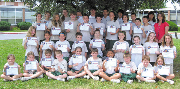 The 2011-12 Mother Seton School Presidential Physical Fitness Award Winners are shown with physical education teacher Danielle Kirby, back row, at right. Front row, from left, Madeline Shea, Libby Kiley, Christopher Nield, Evan Ott, Natalie Bosche, Jacob Hartness, Keola Evans, Sean Himes, Emmanuel Luzuriaga and Emma Reed. Second row, Camille DeSanto, Summer Ruskey, Grace Mazaleski, Eric Himes, Lucy Estep, Halle Houck, Gabby Ferraro, Elizabeth Buchheister and Vanessa Witmer. Third row, Kimberlee Ahlers, Madison Herring, Mark Golibart, Justin Reaver, Michael Kiley, Carrie Reaver, Mackenzie Kirby, Max Kirby, Jonas Holz. Back row, Nora Stocksdale, Caroline Mace, Nicholas Reaver, Brad Reaver, Lucas Torres, Andrew Bramson, Sean Vietri and Samantha Mariano. Missing from photo: Carleton Walker and all eighth-graders.
