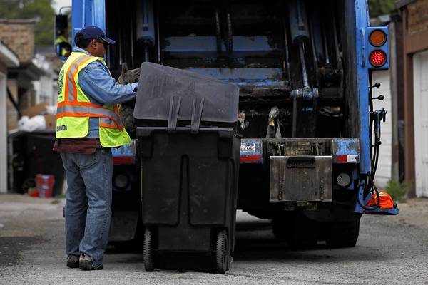 City of Chicago Streets and Sanitation workers pick up garbage in the alley behind the 6400 block of N. Francisco Ave. The garbage grid is a key part of Mayor Rahm Emanuel's cost-cutting plan. He's banking on $20 million in savings this year from the change, which frees up garbage trucks from matching their pickups to the byzantine contours of Chicago's wards.
