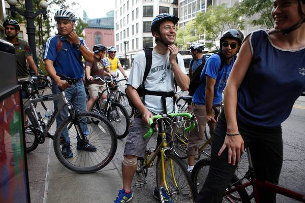 Jewish and Muslim cyclists gather downtown Sunday for an eight-mile bike tour from a Chicago mosque to a synagogue.