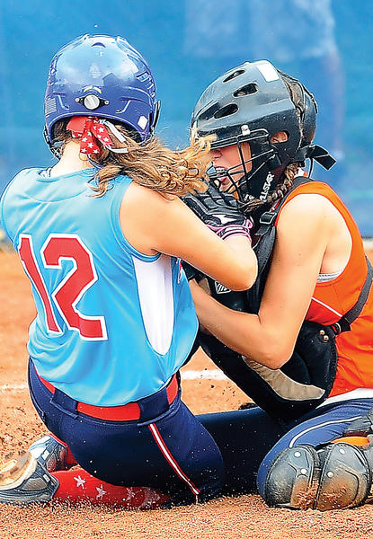 Halfway's Jazmine Yost (12) collides with Delmar catcher Kelsie Hughes at the plate on Sunday during a 7-1 loss in the Maryland State Softball tournament. Yost was out on the play.