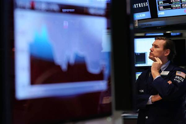 Disillusioned with the conventional buy-and-hold approach after two punishing bear markets in the last decade, some people are trading the mutual funds in their 401(k) plans more frequently. Above, a trader works on the floor of the New York Stock Exchange.