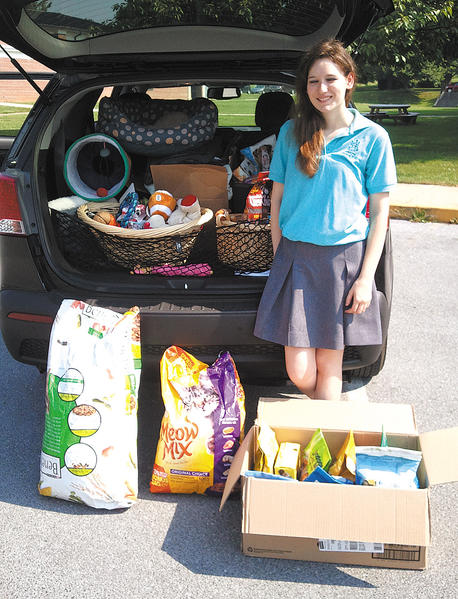 St. Maria Goretti High School student Sarah Ganassa, president of the People for Animal Welfare Society at the school, delivers items to the Humane Society of Washington County.