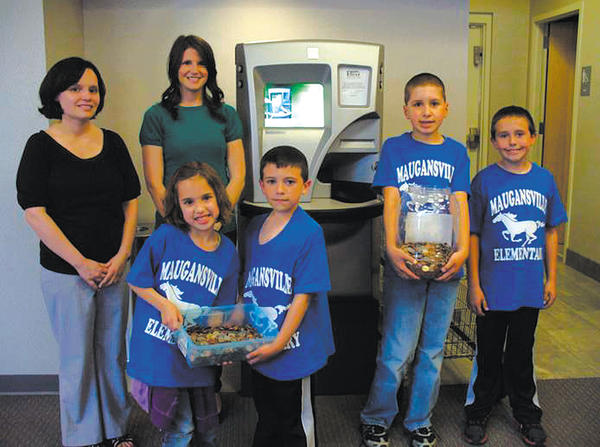 In April, to help students from Maugansville Elementary School and their teachers, Patriot Federal Credit Union let them use the credit union's coin counter for free to add up their fundraising efforts to benefit the Washington County Humane Society. The teachers are, from left, Cortney Wade and Angeline Beal. The students are, from left, Rachel Hebb, Hayden Sweeney, Adam Hebb and Cooper Sweeney.