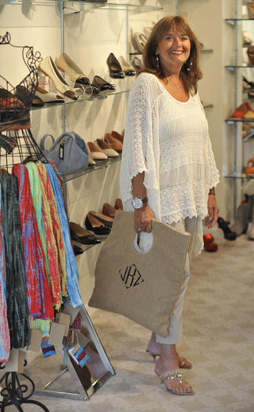 "When we spotted Jody Kesner at Joanna Gray shoes, we could tell she had a Boho chic vibe going on. It started with here fantastic cream fringe top by Heart Loom from Essentials by Panache. She paired it with beige capri's by <a class=""taxInlineTagLink"" id=""PRDCAS0000755"" title=""DKNY"" href=""/topic/services-shopping/clothing-accessories-shoes/dkny-PRDCAS0000755.topic"">DKNY</a> from Loehmann's. We loved the manager's jewel embroidered Giuseppe Zanotti sandal heels. Her oversized tote from the Monogram Shop kept in tune with the color palette. She purchased her cuffs from A Style Studio. Her dangling earrings were from Anthropologie. Her necklace was purchased at Heirloom Jewels. ""Great style means wearing what you feel comfortable in and what looks good on you,"" the 58-year-old <a class=""taxInlineTagLink"" id=""PLGEO100100603120000"" title=""Pikesville"" href=""/topic/us/maryland/baltimore-county/pikesville-PLGEO100100603120000.topic"">Pikesville</a> resident said."