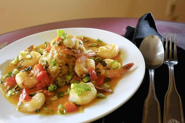 Mofongo is classic Puerto Rican mashed fried plantains with shrimp sauce, on the menu for $9 at Suso Latino Basket.