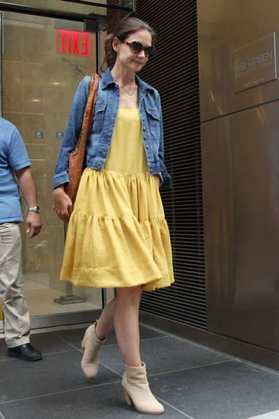 "Katie Holmes leaves her lawyer's office in New York City on July 7, 2012. On July 9, 11 days after  Holmes filed for divorce, she and Tom Cruise reached a settlement.   In a statement, New Jersey divorce lawyer Jonathan Wolfe wrote, ""The case has been settled and the agreement has been signed. We are thrilled for Katie and her family and are excited to watch as she embarks on the next chapter of her life.""  Wolfe also  thanked Cruise's attorneys for ""their professionalism and diligence that helped bring about this speedy resolution."""