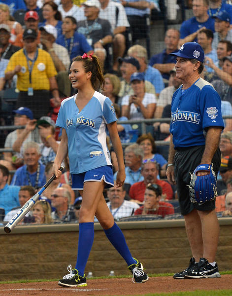 Model Chrissy Teigen and MLB Legend Steve Garvey participate in the 2012 Taco Bell All-Star Legends & Celebrity Softball Game at Kauffman Stadium on July 8, 2012 in Kansas City,