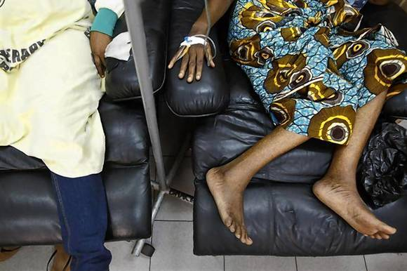 Cancer patients sit in a chemotherapy ward while receiving treatment at the Korle Bu Teaching Hospital