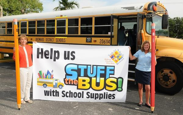 "Dawn McCormick, left, and Jorene Jameson promote the Broward Education Foundation's ""Stuff the Bus"" campaign. A school bus is parked outside the Tools for Schools Broward school supply center as part of the campaign to gather materials for underprivileged Broward students to use throughout the school year. Donations can be dropped off at 2300 W. Copans Road, Pompano Beach. Local businesses throughout Broward County are being asked to collect school supplies from their customers and employees by displaying collection bins in their offices or retail locations. The bins are provided by Waste Management and decorated with artwork from Broward County students as well as students at the Museum of Art Fort Lauderdale Summer Academy. To request a bin, call Mari-Lee Baxter at 754-321-2034 or email Mari-lee.baxter@browardschools.com. For more information, visit www.BrowardEdFoundation.net."