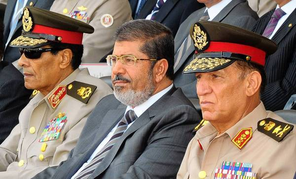 Egyptian military leader Field Marshal Mohamed Hussein Tantawi, left, President Mohamed Morsi and military chief of staff Sami Anan attend a graduation ceremony of cadets in Cairo.