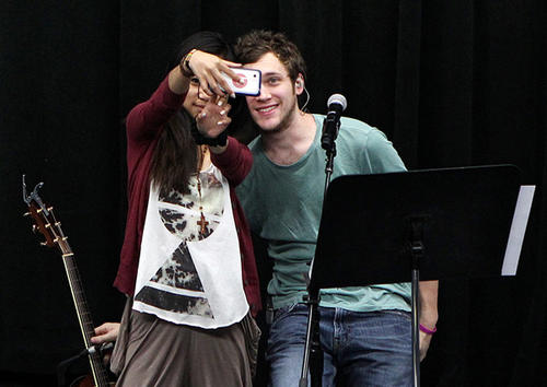 """American Idol"" Season 11 winner Phillip Phillips and runner-up Jessica Sanchez take a photo together during a rehearsal for the ""American Idol"" Live 2012 tour."