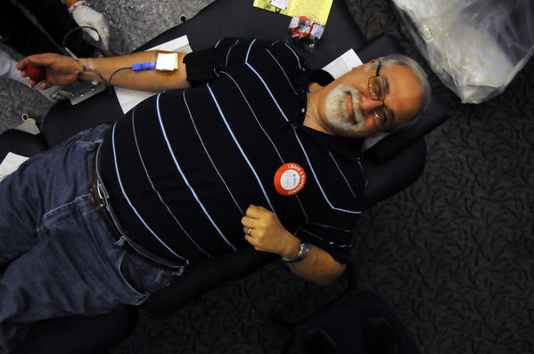 "Alan Gittleman donates his 144th pint of blood durning a Red Cross blood drive at his synagoge Temple Beth Hillel in South Windsor Monday. That's 18 gallons over 34 years of giving a pint at a time. ""It's the easist thing to do"" said Gittleman."
