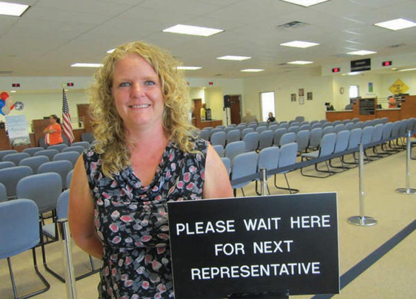 Tabitha Bolyard, manager of the new Martinsburg Division of Motor Vehicles office, stands in the spacious main area of the new facility.