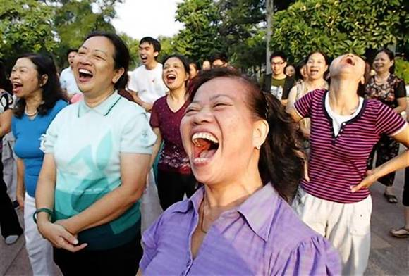 Members of the Laughter Yoga club practise laughing during morning exercise at a public park in Hanoi