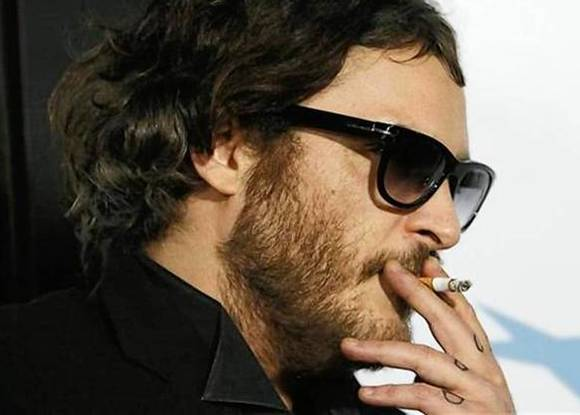 Joaquin Phoenix smokes a cigarette at the Los Angeles premier