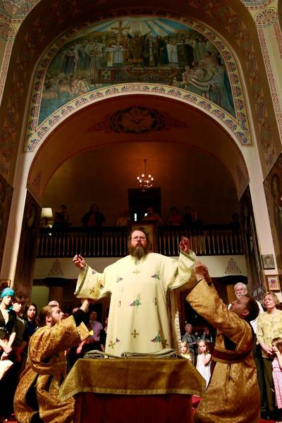 Metropolitan Jonah, center, is vested by Subdeacon Brother Gregory, left, and Subdeacon Gregory Lardin before a 2009 service at Holy Trinity Cathedral in Chicago.