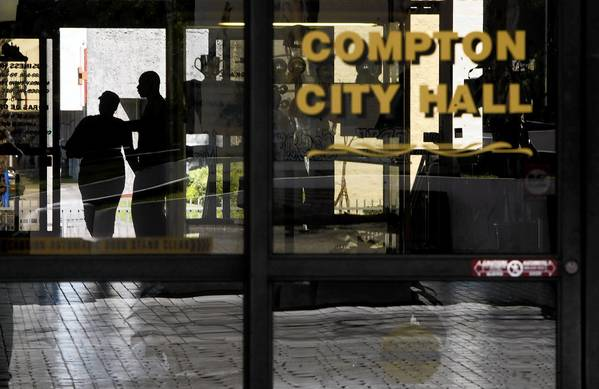 Visitors enter Compton City Hall. The city's already fragile finances became even more so when its independent audit firm, Mayer Hoffman McCann, quit late last month and refused to sign off on the city's financial statements.
