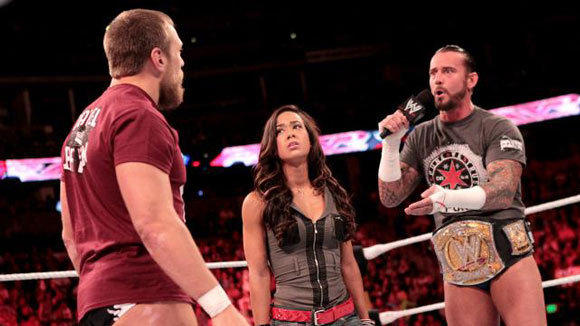 Daniel Bryan, left, AJ and CM Punk have quite the love triangle.