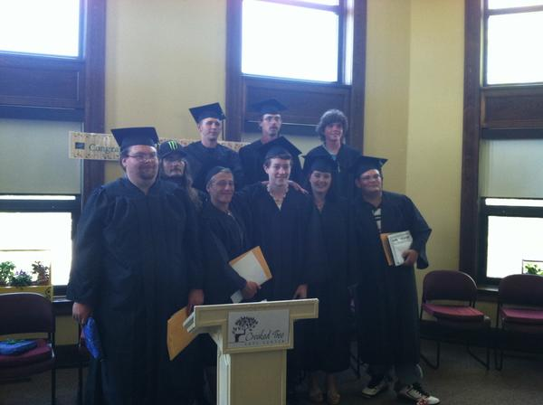 Members of the first Petoskey YouthBuild graduation class are (front row,from left) Robert Ladd, Jeno Mitchum, Rex McPhee, Megghan Golovich, Alan Boda and (back row) Jacob Nagy, Jeramy Stow, Ken Jones and Ben Frost