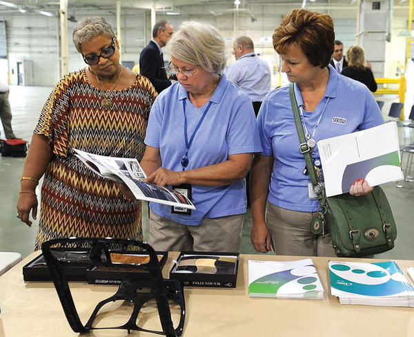 Diane Travis, left, with the state Office of Employment and Training, Michelle Stevens and Michelle Wilson, with Sekisui, look at some of the products Monday to be manufactured by Taica Corporation. The company announced the opening of its first North American manufacturing plant in Winchester. The new plant is expected to create 30 new jobs.
