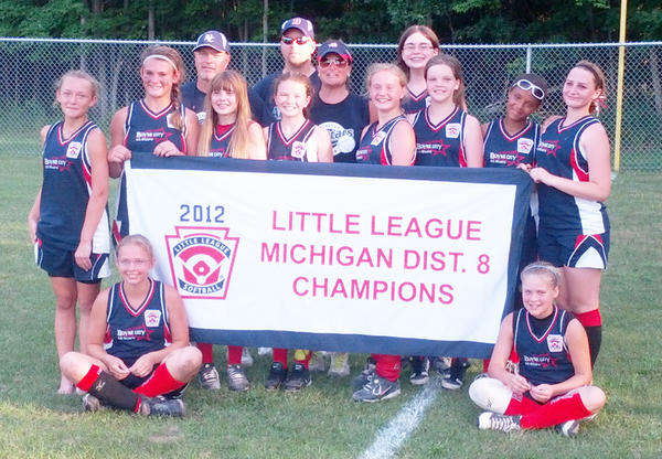 Members of the Boyne City Major (ages 11-12) Little League softball team gather after capturing the District 8 championship over the weekend. Team members are front (from left) Katelynn Wilson, Makhaylee Fiel; middle, Kelsey Hubbard, Katie Hoth, Hailey Fogo, Lauren Fitzpatrick, Olivia Looze, Carrie Butka, Taylor Delaney, Amber Weiss; back, coaches John Looze and Chris Fiel, manager Michele Hoth, Alison Alger.