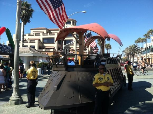 "The replica sail barge from ""Return of the Jedi"" made its way through downtown Huntington Beach during the Course of the Force on Sunday."