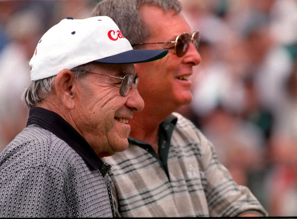 To be with Yogi Berra means you'll smile. Berra and Fuzzy Zoeller enjoyed playing in the Canon GHO on July 1, 1998.