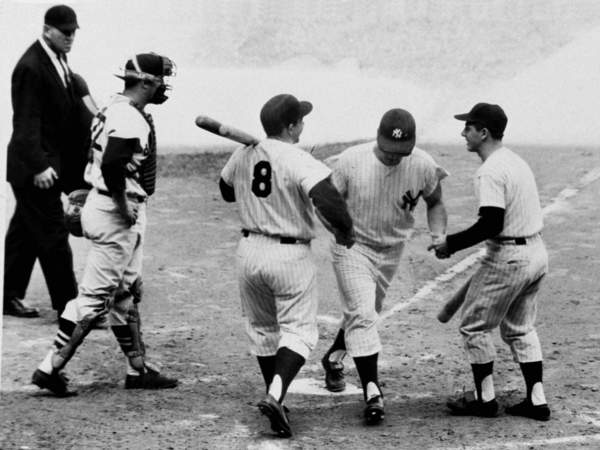 Yogi Berra (No. 8) is the first to congratulate Roger Maris after Maris hit home run No. 61 on Oct. 1, 1961.