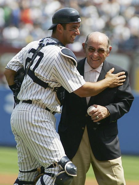 Jorge Posada and Yogi Berra represent all that is good about Yankees catchers. The two good buds share a nice moment on the eve of Yogi's 80th birthday on May 11, 2005.