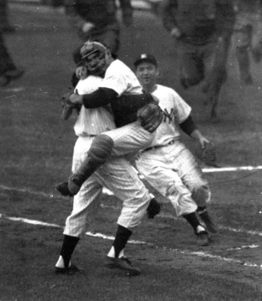 Yogi Berra leaps into the arms of Don Larsen after the Yankees pitcher threw the only perfect game in World Series history on Oct. 8, 1956.