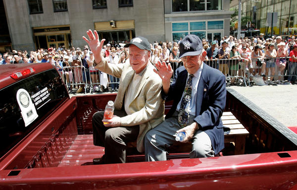 Whitey Ford (left) and Yogi Berra enjoy the ride during the All-Star parade in New York on July 15, 2008.