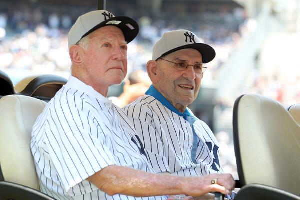 Whitey Ford and Yogi Berra arrive at Old-Timers' Day in the Bronx on July 1, 2012.